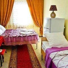 Гостиница Home Стандартный семейный номер с разными типами кроватей фото 3