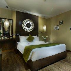 Oriental Suite Hotel & Spa 4* Улучшенный номер двуспальная кровать фото 3