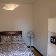 Отель Hospedarte Suites сейф в номере