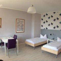 Отель Apartcity-Serviced Apartments Германия, Берлин - 1 отзыв об отеле, цены и фото номеров - забронировать отель Apartcity-Serviced Apartments онлайн комната для гостей фото 3