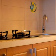 Апартаменты Fenghuang Rujia Holiday Apartments - Sanya Bay Branch удобства в номере