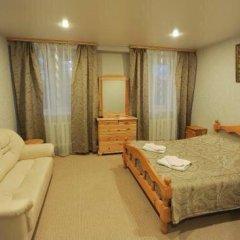 Мини-отель Гостевой двор Стандартный семейный номер разные типы кроватей