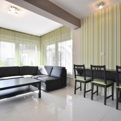 Апартаменты Dom & House - Apartments Sunrise Сопот комната для гостей фото 5
