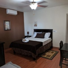 Отель Rockhampton Retreat Guest House 3* Люкс с различными типами кроватей