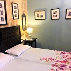 Отель Luciano Valletta Boutique комната для гостей