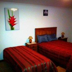 Отель Casa Do Brasao Стандартный семейный номер с двуспальной кроватью фото 10