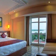 Royal Riverside Hoi An Hotel 4* Номер Делюкс с различными типами кроватей фото 8