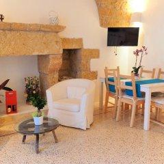 Отель Holiday home La Corte dei Pirri Италия, Гальяно дель Капо - отзывы, цены и фото номеров - забронировать отель Holiday home La Corte dei Pirri онлайн комната для гостей фото 2