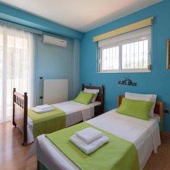 Отель Villa Rea Греция, Петалудес - отзывы, цены и фото номеров - забронировать отель Villa Rea онлайн комната для гостей фото 4