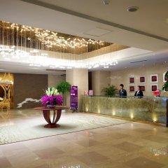 Отель Yitel Xian Big Wild Goose Pagoda Китай, Сиань - отзывы, цены и фото номеров - забронировать отель Yitel Xian Big Wild Goose Pagoda онлайн интерьер отеля фото 2