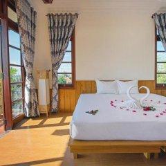 Отель Tropical Garden Homestay Villa 2* Стандартный номер с двуспальной кроватью фото 3