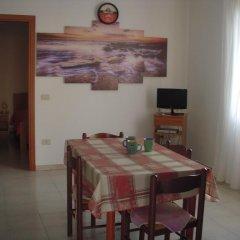 Отель Appartamento La Caletta Синискола в номере фото 2