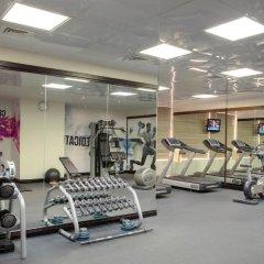 Отель Jumeira Rotana фитнесс-зал фото 3