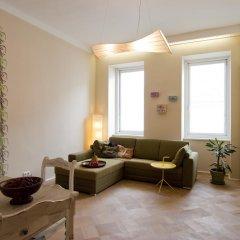 Апартаменты The Rooms Apartments комната для гостей