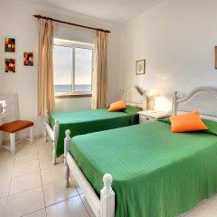 Апартаменты Inn the Beach Apartments комната для гостей фото 4