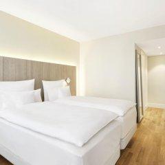 Отель NH Collection Hamburg City 4* Улучшенный номер с различными типами кроватей фото 2