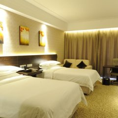 Vienna International Hotel комната для гостей фото 3