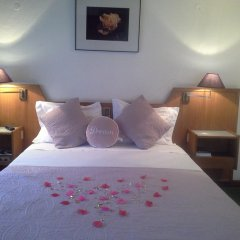 Hotel Amaranto комната для гостей