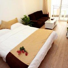 Апартаменты Jietai Xingzheng Apartment комната для гостей фото 5