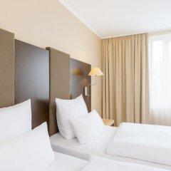 Отель NH Collection Berlin Mitte Am Checkpoint Charlie 4* Стандартный номер с разными типами кроватей фото 4