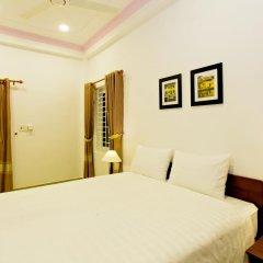 Отель Hung Do Beach Homestay 3* Улучшенный номер с различными типами кроватей фото 4