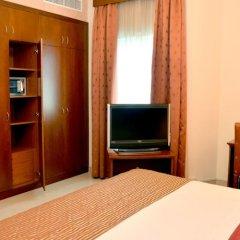 Legacy Hotel Apartments сейф в номере