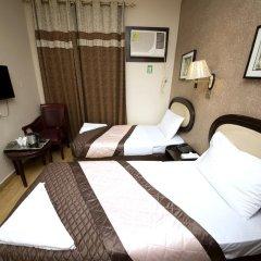 Grand Sina Hotel Стандартный семейный номер с двуспальной кроватью фото 3