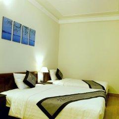 Отель An Hoi Town Homestay 2* Стандартный семейный номер с двуспальной кроватью фото 3