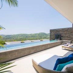 Отель Villas Overlooking Layan бассейн