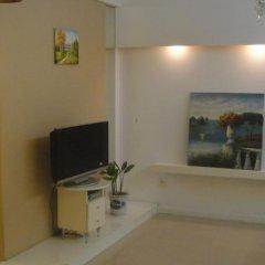 Апартаменты Yijia Apartment (Shenzhen City World) комната для гостей фото 4