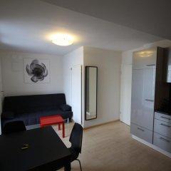 Апартаменты Letzigrund Apartments комната для гостей фото 3