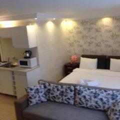 Отель Defne Suites Улучшенные апартаменты с различными типами кроватей