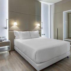 Отель NH Milano Touring 4* Улучшенный номер разные типы кроватей фото 9