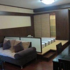Апартаменты Yijia Apartment (Shenzhen City World) комната для гостей фото 5