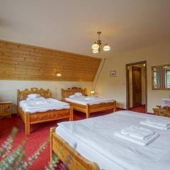Отель Pensjonat Zakopianski Dwór 3* Стандартный семейный номер с двуспальной кроватью фото 4