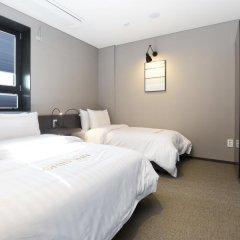 Отель Grid Inn 2* Стандартный номер с различными типами кроватей фото 2