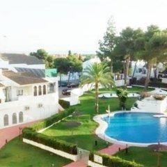 Отель Chalets Con Piscina Испания, Пуэрто Де Санта Мария - отзывы, цены и фото номеров - забронировать отель Chalets Con Piscina онлайн балкон