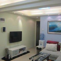 Апартаменты Yijia Apartment (Shenzhen City World) комната для гостей фото 2