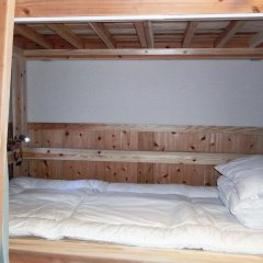 Отель Guesthouse Yakushima 2* Кровать в мужском общем номере