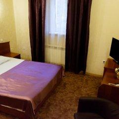 Гостиница Дюма Стандартный семейный номер с двуспальной кроватью