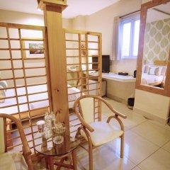 Thuy Sakura Hotel & Serviced Apartment 3* Номер Делюкс с различными типами кроватей фото 9