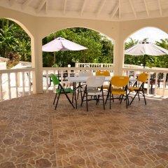 Отель Retreat Guest House Ямайка, Дискавери-Бей - отзывы, цены и фото номеров - забронировать отель Retreat Guest House онлайн питание