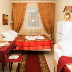 Гостиница Home Стандартный семейный номер с разными типами кроватей