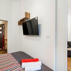 Апартаменты Koscielna Apartment Old Town сейф в номере