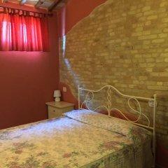 Отель Dedicato A Te Монтелупоне комната для гостей фото 3