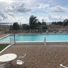 Отель Mango Walk Country Club Suites бассейн
