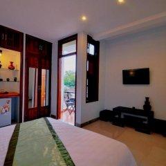 Отель Starfruit Homestay Hoi An 2* Улучшенный номер с различными типами кроватей фото 10