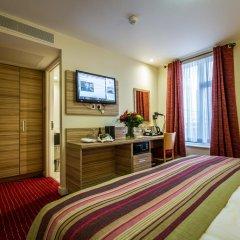 Отель Holiday Inn London - Kensington 4* Улучшенный номер с различными типами кроватей фото 9