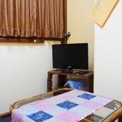 Отель Sudomari Minshuku Friend Якусима комната для гостей фото 4