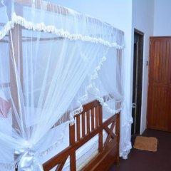Отель Midigama Holiday Inn в номере